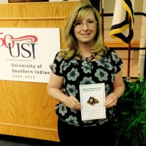 Penny Thompson was inducted into the Delta Epsilon Iota honor society