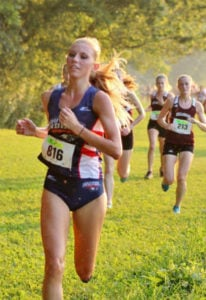 Alyssa Moore competes in cross country for USI as an undergraduate